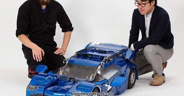 Robotics Engineers at Work on Real Transforming Car Robot