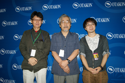 Shinkai, center, with directors Kazuya Murata (left) and Noboru Ishiguro (right)